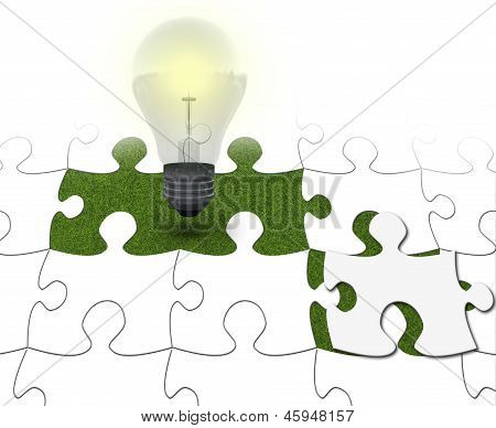 Close Up Of Puzzle With Light Bulb