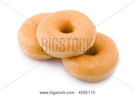 Three Doughnuts Or Donuts Piled