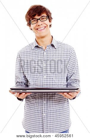 Smiling college student holding closed laptop. Isolated on white background, mask included