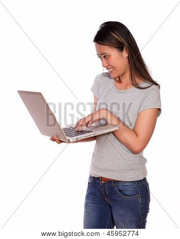 Charming Asiatic Woman Using Her Laptop Computer