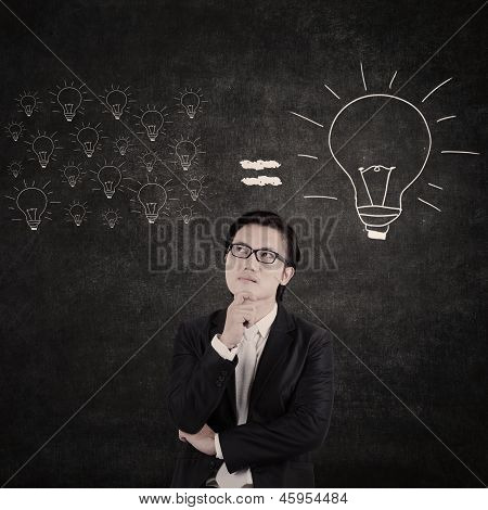Asian Businessman Think Of Big Idea