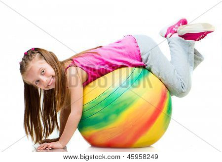 Little girl doing gymnastics with ball over white background