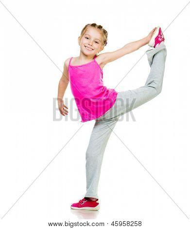Little girl doing gymnastics over white background
