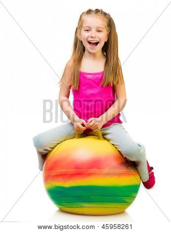young girl doing gymnastics with ball over white background