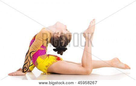 beautiful little girl gymnast isolated on a white background