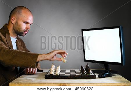 human chess player against computer on gray background