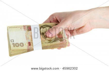 Ukrainian money in hand, isolated on white