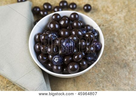 Bowl Filled With Blueberries And Chocolate Balls