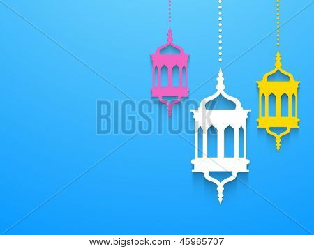 Hanging colorful Arabic lamps or lanterns on blue background, concept for Muslim community holy month Ramadan Kareem or Ramazan Kareem.