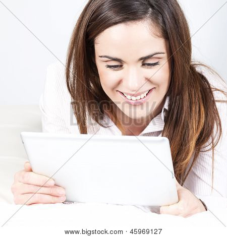 Woman On Sofa With Tablet