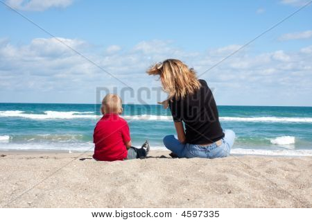 Mother And Child On The Beach