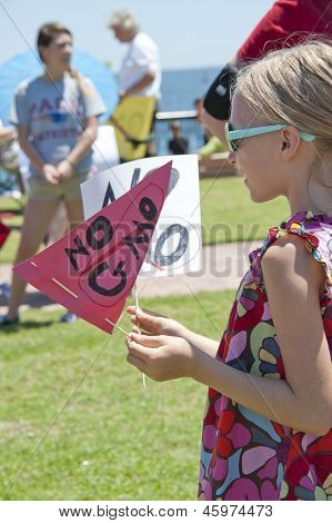 """PENSACOLA, FL - MAY 25: Protesters rally in Pensacola, FL on May 25, 2013 to show support for worldwide """"March on Monsanto"""" day to express concern over GMO (genetically modified) foods and labeling."""