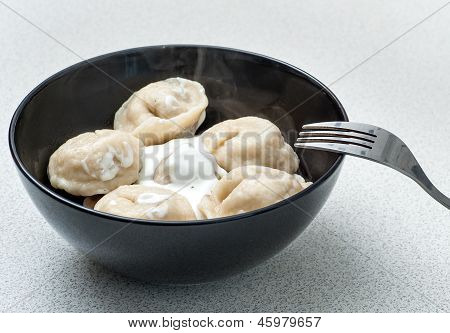 sour cream pelmeni on a table