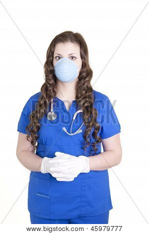 Health Care Worker In Scrubs, Mask And Gloves