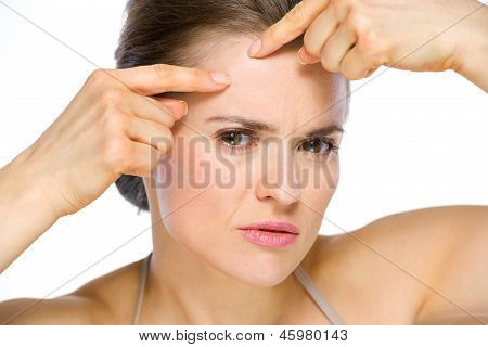 Beauty Portrait Of Young Woman Squeezing Acne