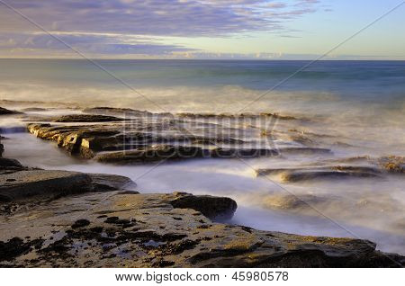Ocean Waves Over Rocks