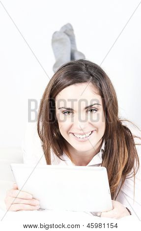 Smiling Woman On Sofa With Tablet