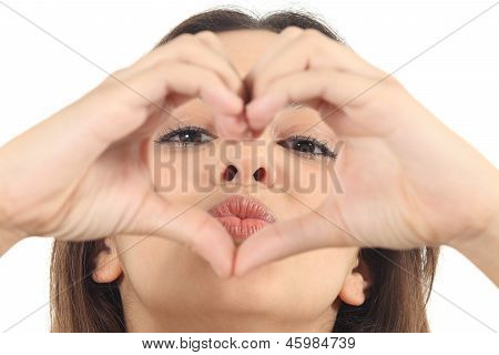 Pretty Woman Making A Heart Shape With Her Hands