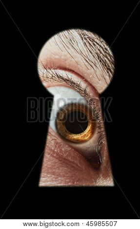 Scared Male Eye Spying Through A Keyhole