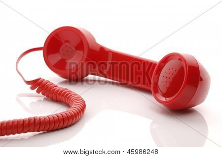 Red old fashioned telephone handset isolated on a white concept for urgent or important customer support call