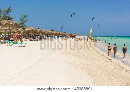 VARADERO,CUBA-MAY 18:Vacationers at the beach May 18,2013 in Varadero, Cuba.With the increasing flow of foreign visitors,tourism in Cuba grew 4.5% in 2012 with Varadero being its main destination