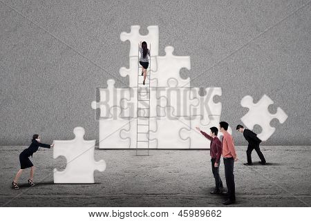 Business Team Build Puzzle Together