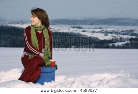 Girl Having Tea In Winter