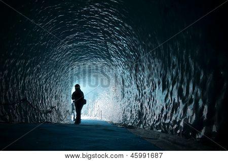 Human Figure Silhouette Inside Ice Cave