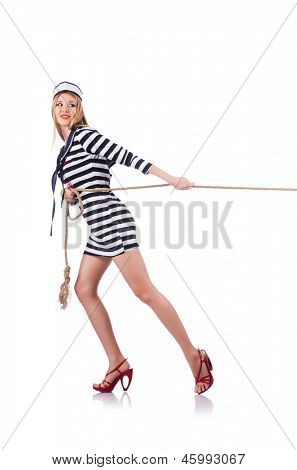 Woman sailor in tug of war concept