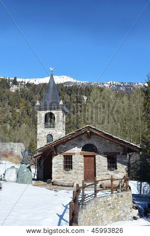Small Stone Mountain Chapel With Snow