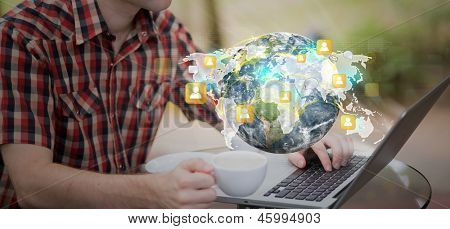 Social networking concept : Business man working with laptop (Elements of this image furnished by NASA)