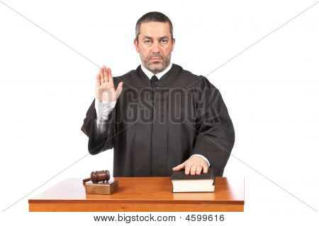Serious Male Judge Taking Oath