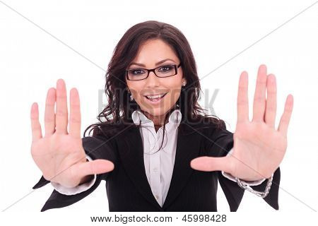 young business woman smiles behind a frame that she makes with her hands. on white background