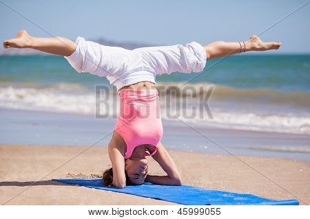 Doing some yoga at the beach