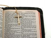 picture of atonement  - gold cross on portion of kjv bible opened to i corinthians 15 - JPG
