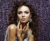 Jewelry. Aristocratic Gorgeous Woman With Shining Earrings. Holiday Makeup