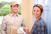 stock photo of fragile sign  - Delivery man and young woman - JPG