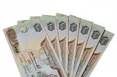 stock photo of dirhams  - Many One Thousand UAE Dirhams currency notes - JPG