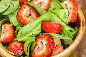 stock photo of vegan  - Strawberry Spinach Salad with Poppy seed and sesame dressing - JPG