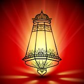 Illuminated decorated Arabic lantern on shiny background, concept for Muslim community holy month Ra