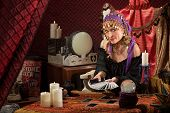 picture of gypsy  - Smiling gypsy soothsayer with hand of tarot cards - JPG