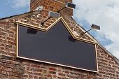 pic of public housing  - Traditional public house or tavern sign on side of old building blank for insertion of pub name - JPG