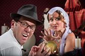stock photo of seer  - Unlucky sneering man with fortune teller and crystal ball - JPG