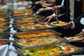 pic of banquet  - people group catering buffet food indoor in luxury restaurant with meat colorful fruits  and vegetables - JPG