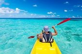 foto of canoe boat man  - Young caucasian man kayaking in sea at Maldives - JPG