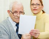 pic of elderly couple  - Senior client and woman agent holding an agreement togetherness - JPG