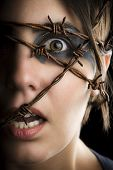 picture of dread head  - Terrified woman with barbed wire around the head - JPG