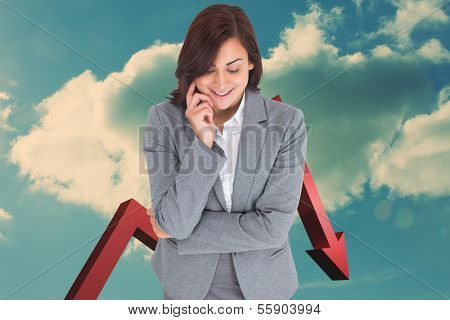 Smiling thoughtful businesswoman against arrow in the sky in blue