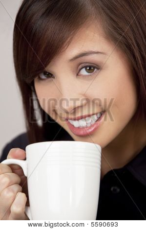 Beautiful Asian Woman Drinking Coffee Or Tea