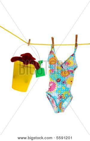 Childs Bathing Suit And Toys On Clothes Line